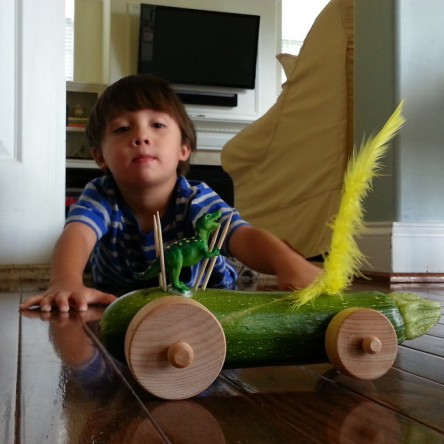 Can you believe 2014 is almost over?  [Another random Ezzie shot - I don't know why the dino is riding the zucchini.]